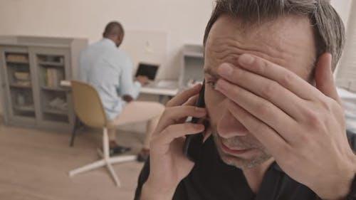 Nervous Manager Talking on Cellphone