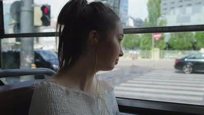 Girl Traveling By Tram in the City