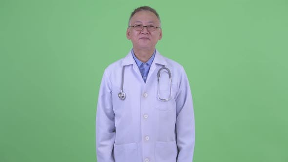Thumbnail for Happy Mature Japanese Man Doctor Bowing
