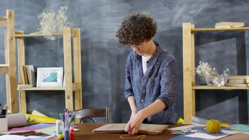Female Decorator Packing Finished Artwork
