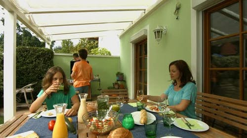 Family Having Barbecue on Terrace