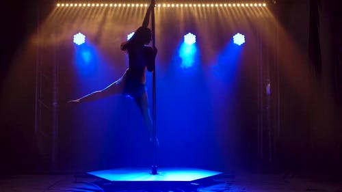 Pole Dance Woman Training. Beautiful Young Woman Doing Pole Dance. Female Dancer Silhouette, Fitness