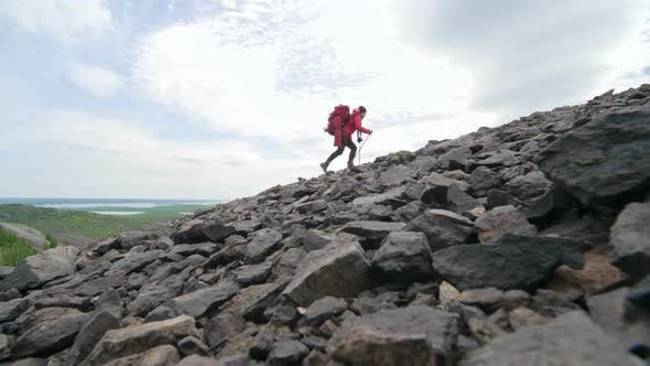 Thumbnail for Female Trekker Walking Up Steep Mountain Alone