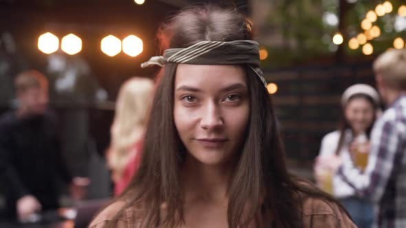 Thumbnail for Pretty Young Woman with Bandanna on Her Head Posing on Camera