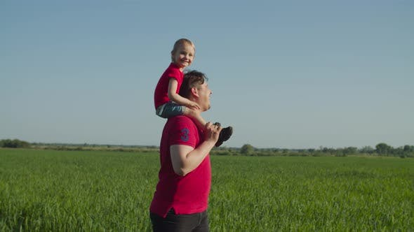 Thumbnail for Dad Piggybacking Laughing Baby Girl in Nature