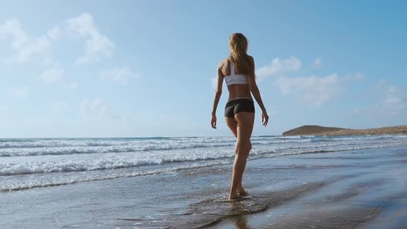 Thumbnail for Woman Bare Foot Walking on the Summer Beach