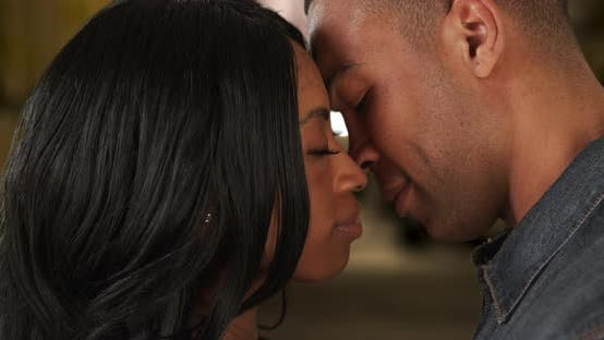 Thumbnail for African-American girlfriend and boyfriend kiss with passion on night out