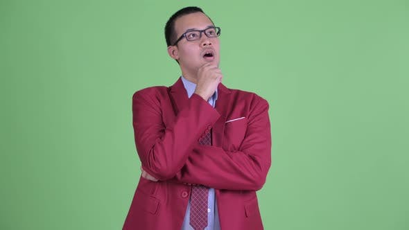 Thumbnail for Happy Asian Businessman with Eyeglasses Thinking