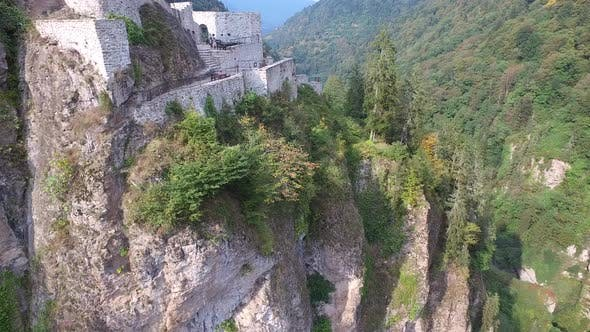 Cover Image for Castle and Watchtower on the Edge of the Cliff in Dense Forest