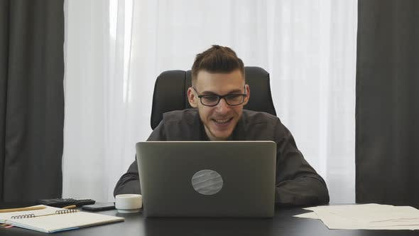 Thumbnail for Happy businessman celebrating victory in front of the laptop. Corporate business success concept