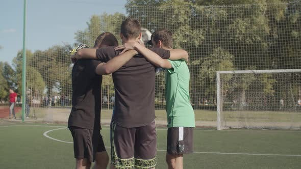 Thumbnail for Street Soccer Team Embracing Before Football Game