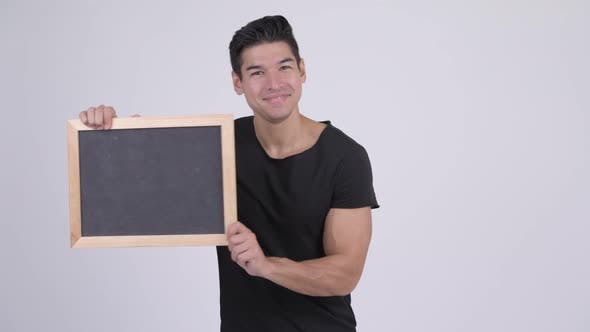 Thumbnail for Young Happy Multi-ethnic Man Surprising and Showing Blackboard