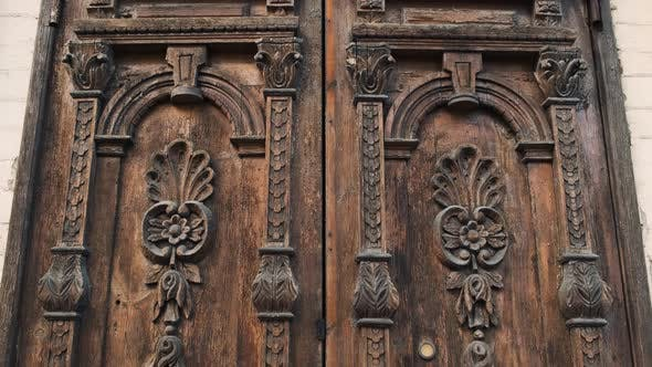 Thumbnail for Tilt-down Shot of an Old Wooden Door in To a Beautiful Ancient Place. Wood Texture Doors