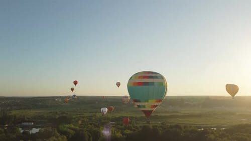Hot air balloons take off to the evening sky at festival