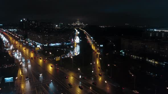 Thumbnail for An Aerial Night View of a Busy Road Against the Endless Urbanscape