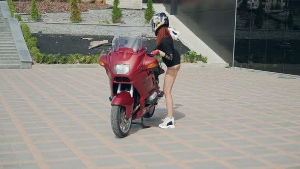 Thumbnail for Female biker on motorbike. Young pretty woman sitting on motorbike