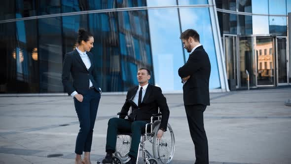 Thumbnail for Cripple Businessman in Wheelchair and Two His Collegues Has Positive Conversation