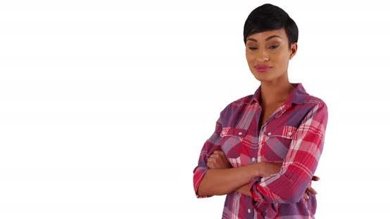 Black female dressed in plaid shirt smiling at camera in studio with copyspace