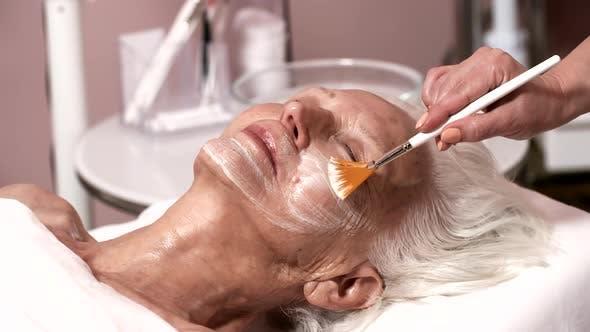 Senior Caucasian Lady Enjoying Facial in Beauty Clinic