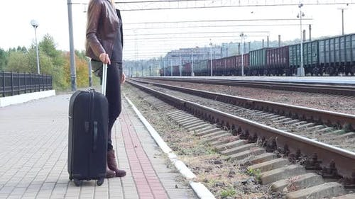 Girl With A Suitcase On The Platform