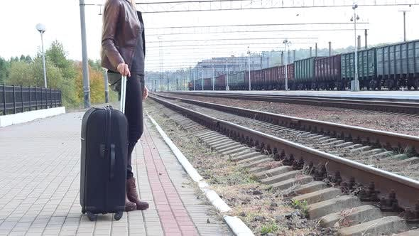 Thumbnail for Girl With A Suitcase On The Platform