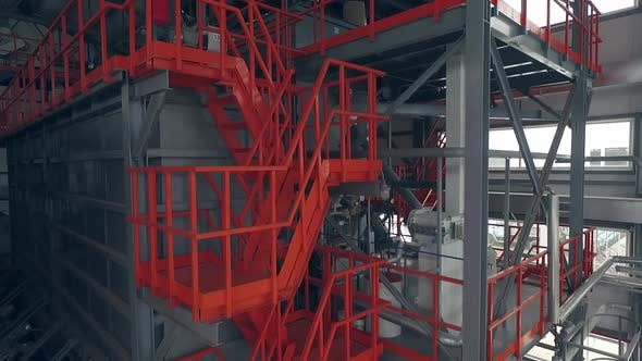 Indoor orange ladders on a wheat mill. Aerial view 02