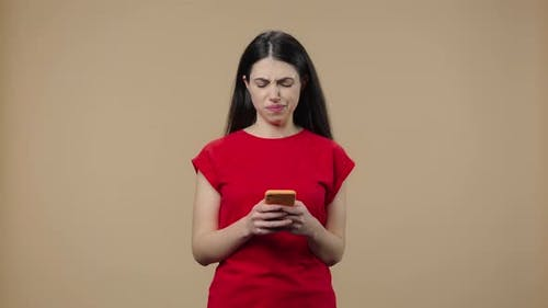 Portrait of a Model with Natural Beauty is Texting on Her Phone
