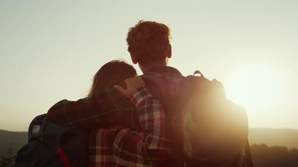 Romantic Couple Enjoying Sunset in Mountains