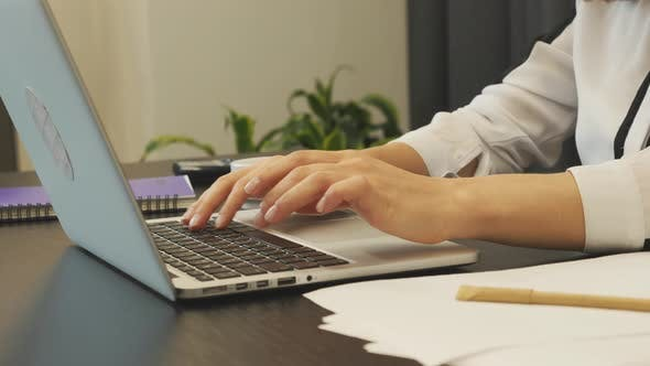 Thumbnail for Female fingers typing on laptop keyboard. Business concept