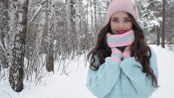 Thumbnail for Stylish Young Woman Walking Towards Winter Forest