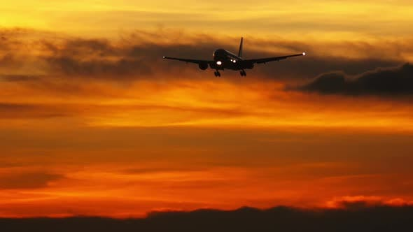 Airplane silhouette in the night sky