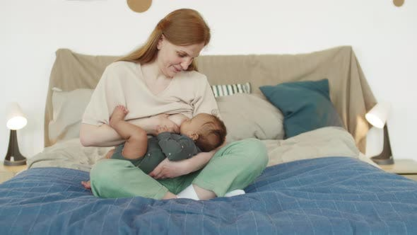 Thumbnail for Happy Mother Breastfeeding Child