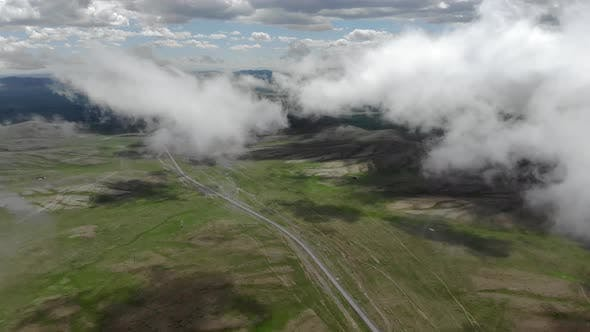Thumbnail for Central Asian Steppes Through Clouds