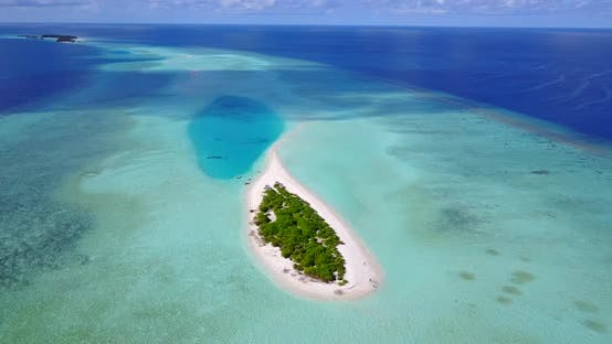 Natural aerial island view of a summer white paradise sand beach and aqua blue water background