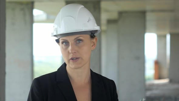 Thumbnail for Construction female worker on building site talking to camera