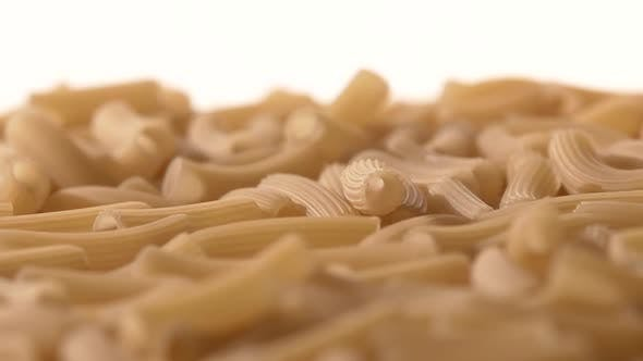 Thumbnail for Falling Down Italian Pasta, on White, Rotation, Close Up, Slow Motion