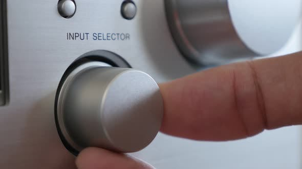 Thumbnail for Hi-Fi in silver  design amp changing sources close-up 2160p 30fps UltraHD footage - Using dial for i
