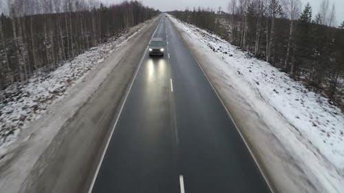 Aerial Shot of Minivan on Winter Road
