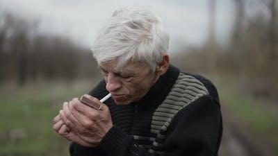 Rural Man Lights a Cigarette