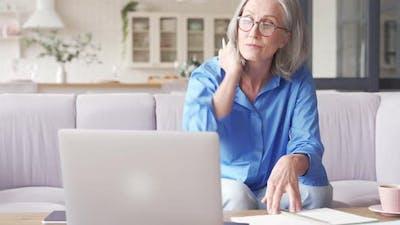 Senior Older Woman Elearning Watching Webinar on Laptop at Home