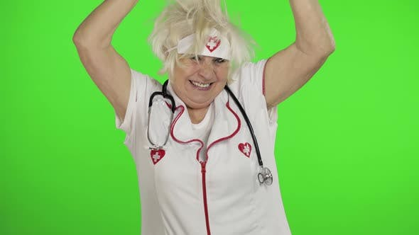 Thumbnail for Portrait of Elderly Caucasian Female Doctor Dance. Crazy and Funny Nurse