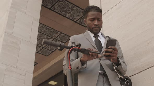 Thumbnail for African Businessman Using Smartphone in Downtown