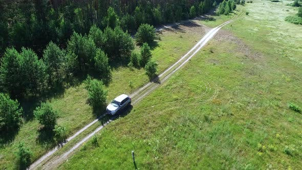 Thumbnail for Copter View Driving Car Through Fields. Copter Filming Automobile at Nature