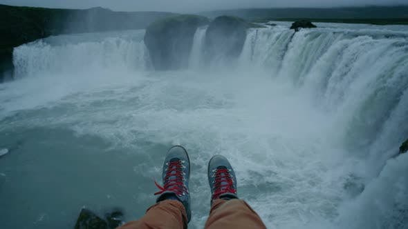 Thumbnail for POV of Boots Hang From Waterfall Cliff