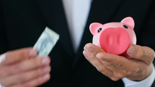 Business Man Putting Money in Piggy Bank, Rich Investor Making Contribution