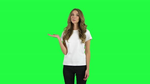 Cover Image for Lovable Girl Talking and Pointing Side Hand for Something, Copy Space. Green Screen