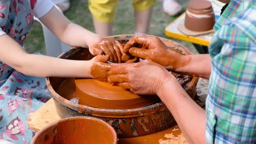 Woman and Girl Making Ceramic Pot in Pottery Workshop