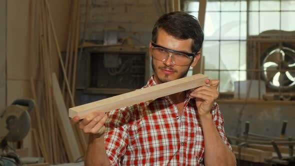 Thumbnail for Bearded Carpenter Examining Wood Piece After Grinding It 1080p