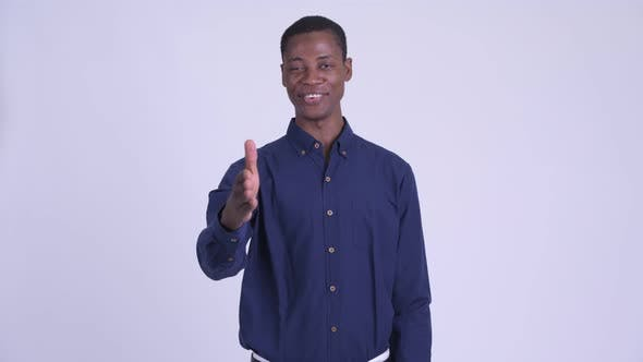Young Happy African Businessman Giving Handshake