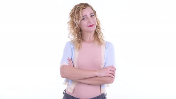 Thumbnail for Happy Beautiful Blonde Woman Smiling with Arms Crossed